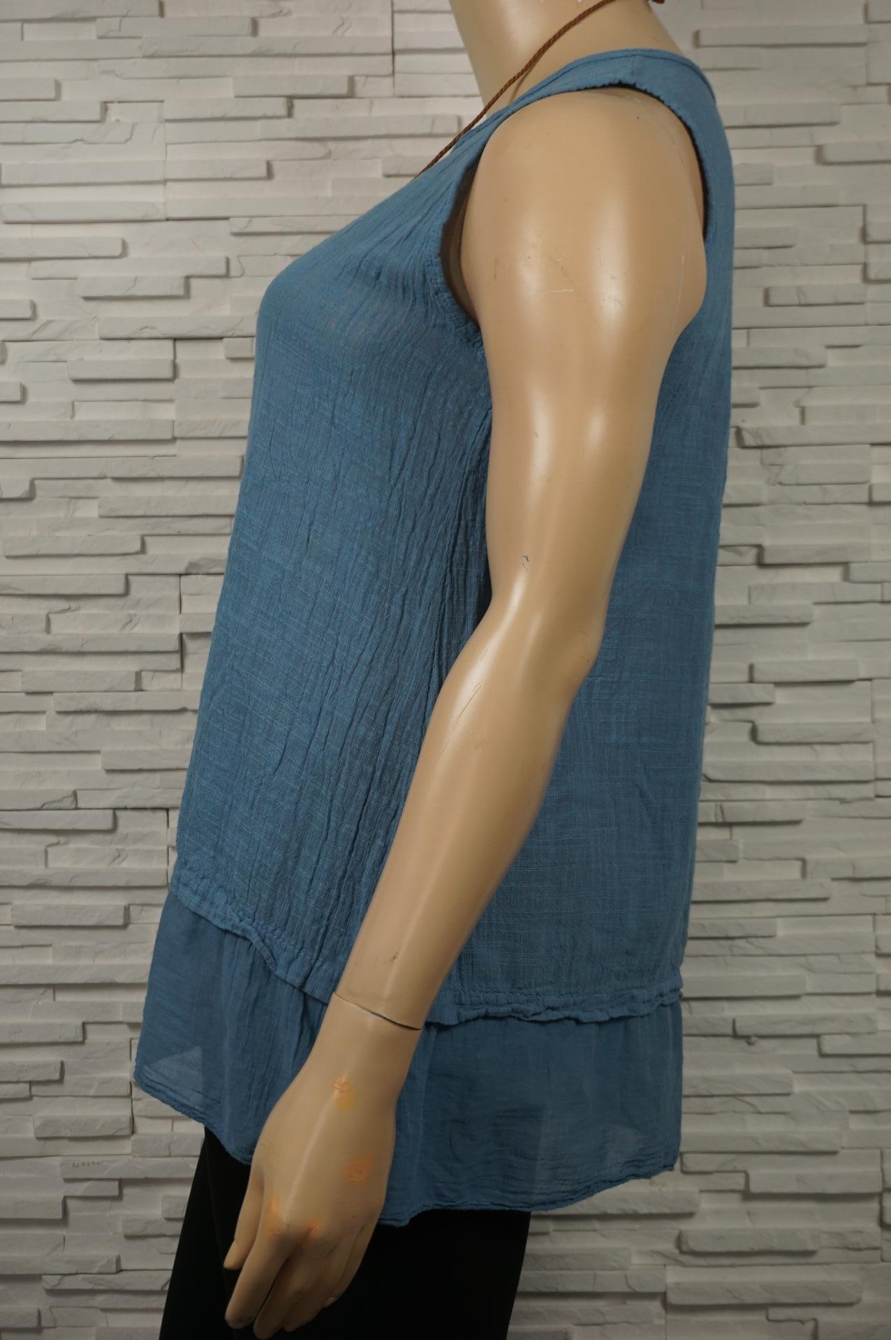 Tunique en coton à volants, sans manches, avec collier.