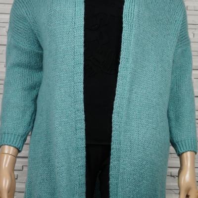 Gilet en laine, long, doux, poils longs.